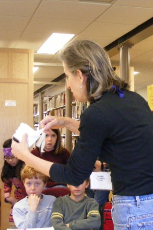 Archivist shows documents to 5th graders.