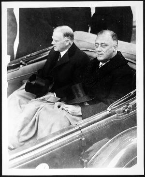 FDR and Hoover w tophats riding to inauguration. 1933.
