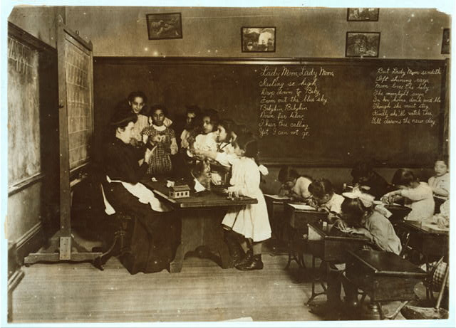 """Steamer Glass [i.e. class]"" in Hancock School, Boston. Immigrant children. Location: Boston, Massachusetts. Source: http://hdl.loc.gov/loc.pnp/nclc.04529"