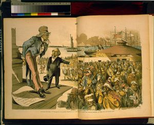 """Uncle Sam"" looks down at a crowd of immigrants with caricatured facial features and wearing the native dress of other countries while a rich man gestures blamingly in the crowd's direction."