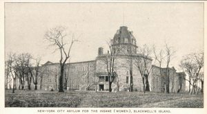 Postcard-style black and white photograph of a wide stone building with a dome.