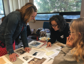 Teachers at an Accessing Inquiry course discussing primary sources