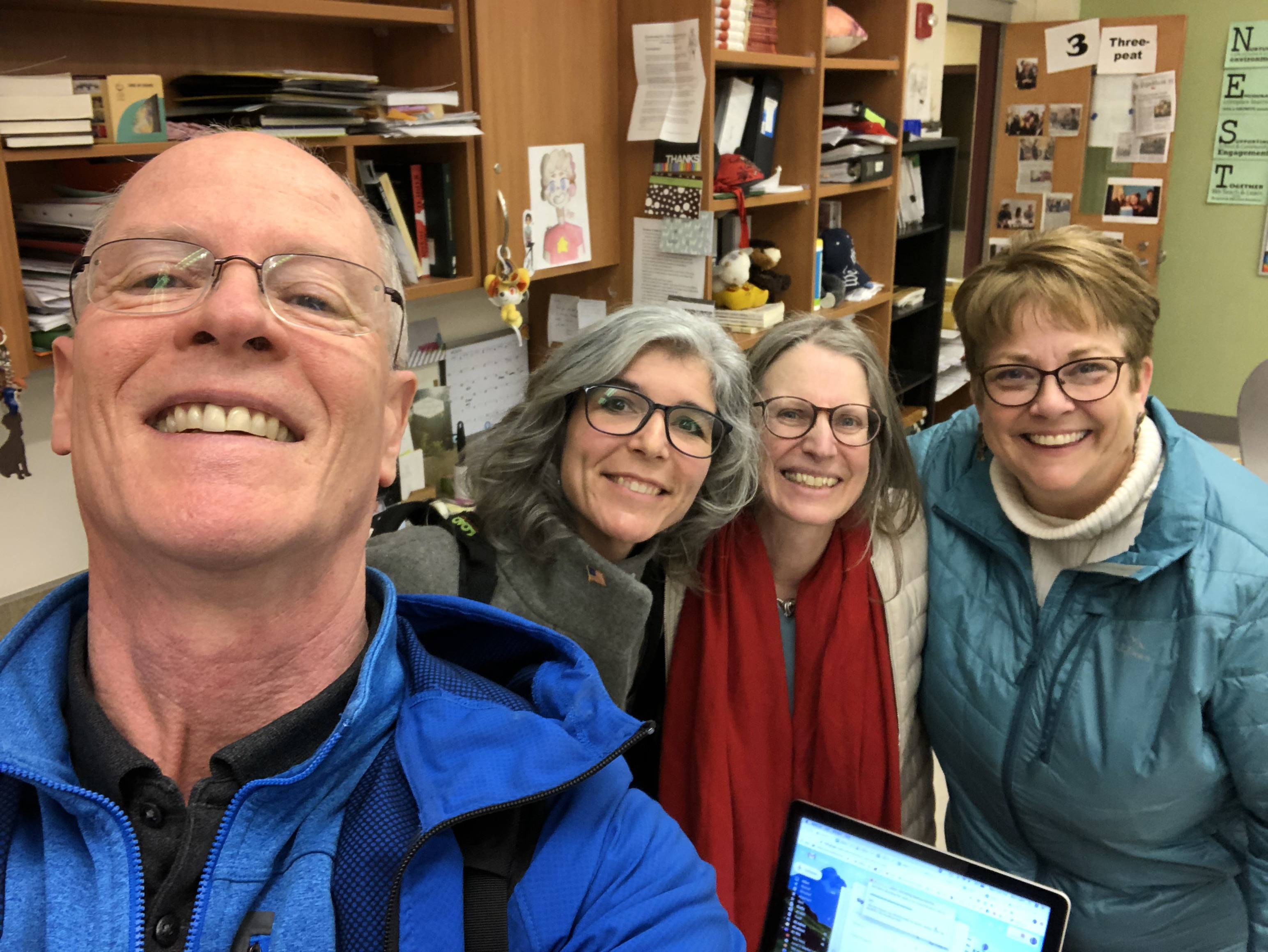 Emerging America director takes a selfie in a classroom with Brown, Risler, and Alison Noyes.