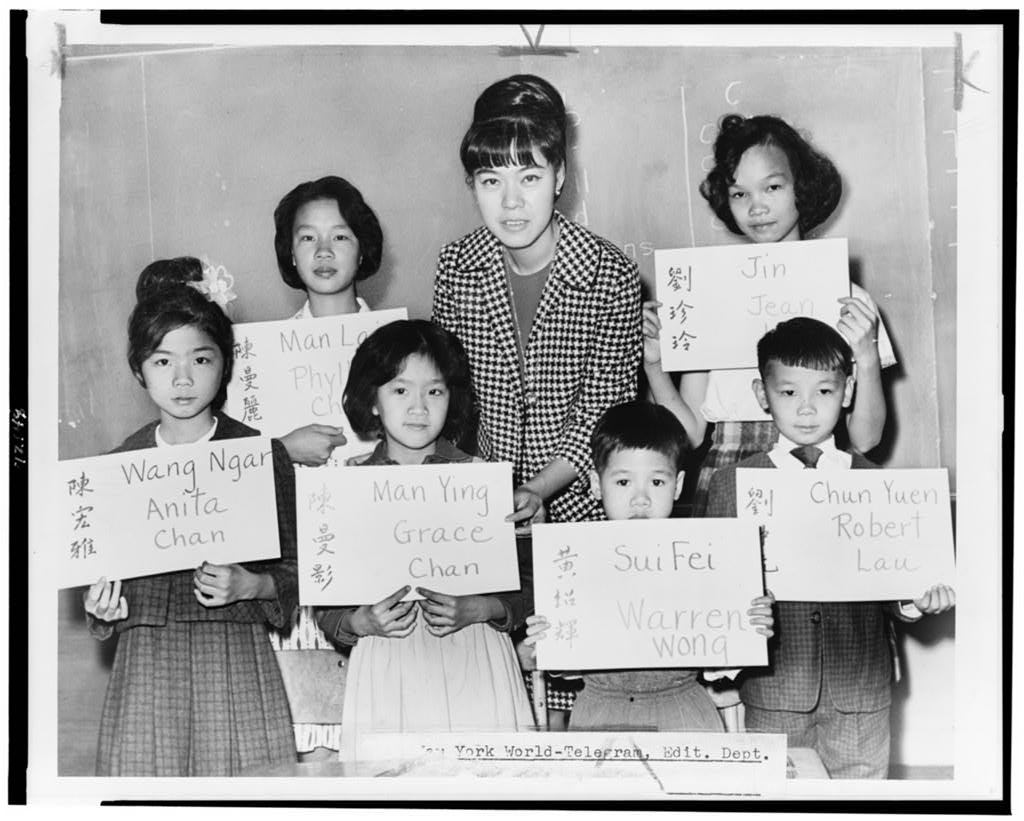 Children recently arrived at a New York City public school from Hong Kong and Formosa with their teacher in a 1964 newspaper photo